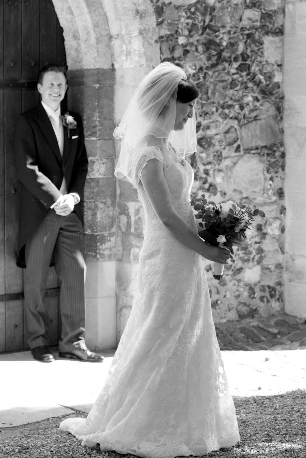 Proud groom looks on