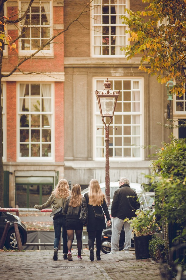 Girls walk down Herenmarkt