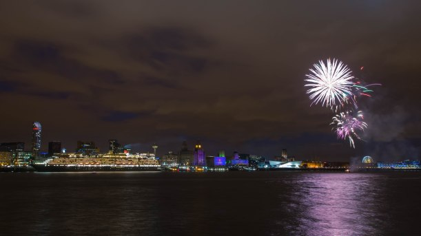 Fireworks light up the docked Queen Victoria